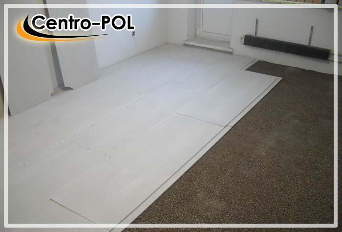 Укладка выравнивающих плит на поверхность сухой стяжки